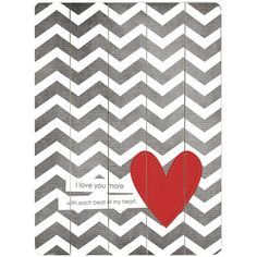 Paneled wood wall art with a chevron motif, heart accent, and typographic details.      Product: Wall art    Construction ...