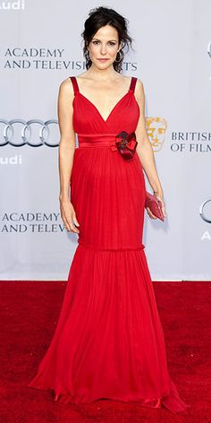 Mary-Louise Parker The Weeds star takes a bold stand on the red carpet, wearing a plunging mermaid gown with floral accoutrements by Dolce & Gabbana.