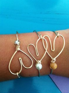 Gold Wire Heart Bracelets by MissChaosLLC on Etsy, $14.00 Im guessing Ariel could make these!