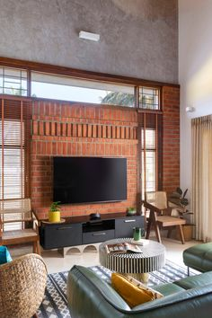 White walls and exposed brick highlight this Bangalore home's design | Architectural Digest India Indian Home Design, Indian Home Interior, Brick Interior, Interior And Exterior, Brick Cladding, Interior Decorating, Interior Design, Interior Ideas, Building A New Home