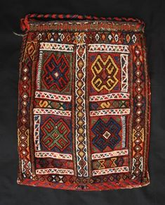 """Antique Spindle-Bag, Afshar Tribes, Southern Persia  A fabulous Spindle-Bag woven by Afshar tribes in southern Persia at the end of the 19th century. The bag is in excellent condition and woven entirely with vegetable colours in soumack technique. A wonderful collectors' piece.  Size: 46cm x 36cm (1' 6"""" x 1' 2"""")."""