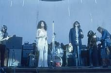Grace Slick and Jefferson Airplane perform at original Woodstock Festival, 1969, in upstate New York.  ©Jason Laure / The Image Works