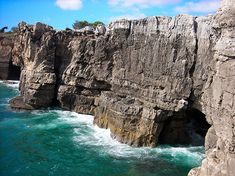 """One of the most famous places to visit in Cascais is """"Boca do Inferno"""" (Hell´s Mouth), this is a unique rock formation on the edge of the ocean. Sea Cave, Cape Verde, Online Travel, Rock Formations, Spain And Portugal, Famous Places, Group Tours, Travel Maps, Eurotrip"""