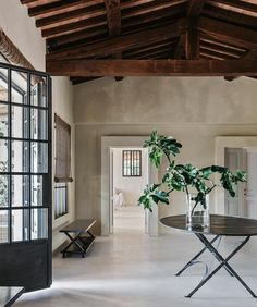 Tour a fashion photographer's Tuscan farmhouse, packed with high beam ceilings, pops of indoor plants and polished floors.