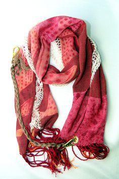 It's great to be able to put on jeans and a T-shirt, but it's even better to put on jeans and a T-shirt, look stylish and get endless compliments. That's what adding an Amber Kane scarf will do to any outfit.  This lightweight ultra feminine scarf is designed to look lux with it's bright spring and summer colors, elegant crocheted edging, and it's edgy hardware.  amberkane.com $250.00