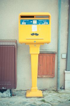 yellow mail box by adroual, via Flickr