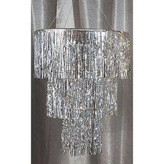 Hang the Silver Three Tier Chandelier for an ultra elegant look on a budget! Our silver tier chandlier is made of mylar measuring 28 inches in diameter.