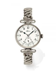LONGINES THE BRIGHTON, n° 20358/8, vers 1919 Montre bracelet en acier. Boîtier rond, anses mob