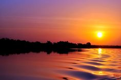 Sunset on Gambia River Photo by Katja Cof -- National Geographic