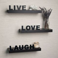 Send your guests a subtle message while livening up your walls with these espresso decorative wall shelves. Place flower vases, small pictures, or candles on each laminated shelf to add appeal to these shelves that feature life-affirming words.