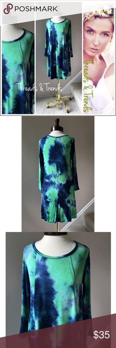 "Navy & Mint Tie Dye Tunic Dress On trend super comfy navy and mint tie dye tunic dress. 3/4 length sleeves. Pair with navy, mint or white leggings. Made of a soft and stretchy rayon/spandex blend.                               Available in S/M, M/L, L/XL   S/M Bust 36"" Length 35""  M/L Bust 38"" Length 35""  L/XL Bust 40"" Length 35"" striped Threads & Trends Dresses"