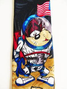 Looney Tunes Cartoon Necktie, Tazmanian Devil Astronaut Planting American Flag ,on the Moon, Black Background Comic Cartoon Novelty Necktie by TomCatBazaar on Etsy Looney Tunes Cartoons, Tasmanian Devil, Cool Ties, Neckties, Astronaut, Happy Planner, Black Backgrounds, Planting, More Fun