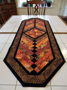 Create a festive seasonal table with this lovely autumn harvest themed table runner. This lovely runner is quilted in a beautiful French braid pattern using a collection of fall fabrics gilded with gold accents and black trim. Table Runner And Placemats, Table Runner Pattern, Quilted Table Runners, Fall Table Runner, Thanksgiving Table Runner, Halloween Table Runners, Braid Quilt, Quilted Table Toppers, Fall Quilts