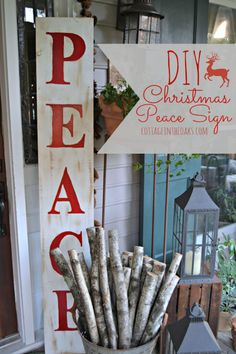 DIY Christmas Peace Sign Tutorial(love the wood at decoration outside) Merry Little Christmas, Christmas Signs, Rustic Christmas, Christmas Projects, Winter Christmas, All Things Christmas, Holiday Crafts, Holiday Fun, Christmas Holidays