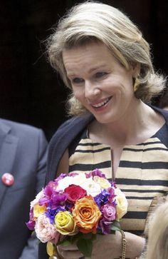 Queen Mathilde of Belgium smiles as she attends the 20th anniversary of the Cliniclowns Belgium organization, in Mortsel, on 15 July 2014
