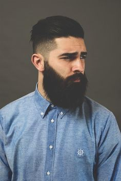 BLue shirt on beardsman.
