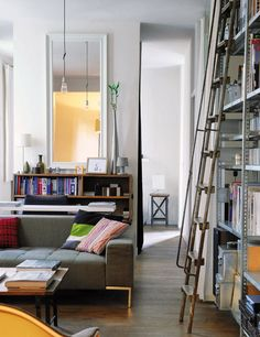 Someday in my dreams, I desire a bookcase so tall I need a ladder to reach my complete collection. A room devoted to my love for books and music, but definitely a more vintage mod vibe, not stuffy and colonial