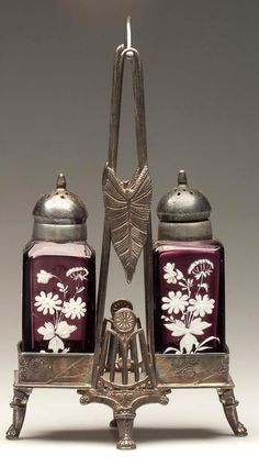 """SQUARE - ROYAL PAIR OF SALT AND PEPPER SHAKERS, amethyst white enamel and gilt floral decoration, matching period two-part lids. Fitted in a quadruple-plate stand marked """"ROCKFORD / SILVER CO"""". Fourth quarter 19th century"""