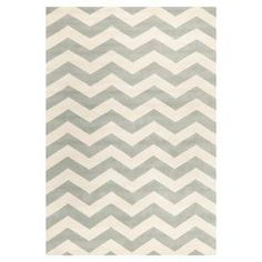 """Anchor your living room seating group or define space in the den with this artfully hand-tufted wool rug, featuring a classic chevron motif for timeless appeal.  Product: RugConstruction Material: Wool and cottonColor: Grey and ivoryFeatures:  Hand-tuftedCotton backingMade in India Pile Height: 0.63"""" Note: Please be aware that actual colors may vary from those shown on your screen. Accent rugs may also not show the entire pattern that the corresponding area rugs have.Cleaning and Care: ..."""