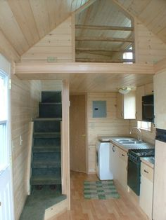Rich the Cabin Mans Extra Long Tiny House on Wheels.with normal stairway