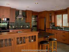 This cherry kitchen features Quality Custom Cabinetry in a Craftsman style.
