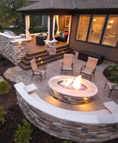 Lower deck to patio that matches upper deck. Features Include: – composite deck – stone grilling station – stamped concrete patio – curved stone bench – gas fire pit with fire glass Backyard Patio Designs, Backyard Landscaping, Backyard Seating, Diy Patio, Landscaping Ideas, Outdoor Seating, Backyard Layout, Cozy Backyard, Deck To Patio Ideas