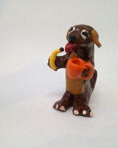 This was modeled after a real dog that really likes coffee and bananas.  Craaazy.