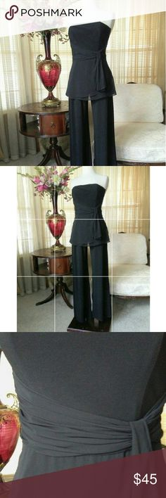 WHBM black jumpsuit In excellent condition. No defects found. It has a bustier so no need to wear a bra   .                         b White House Black Market Pants Jumpsuits & Rompers