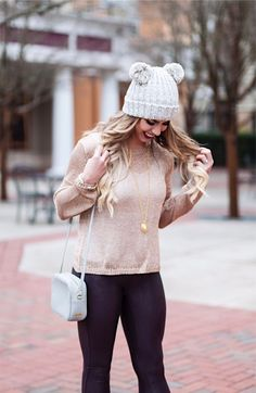 double pom pom beanie, pom pom beanie, spanx wine faux fur leggings, gold metallic sweater, lace up gray vince camuto heels, julie vos pendant necklace, gigi new york purse, winter fashion, winter outfit ideas, winter outfit inspo