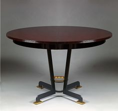 Jules Leleu, Rare circular dining table in deep wine coloured lacquer oak