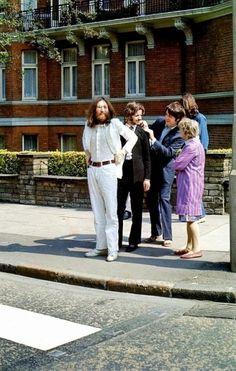 Beatles prepare to cross Abbey Road. 1969.