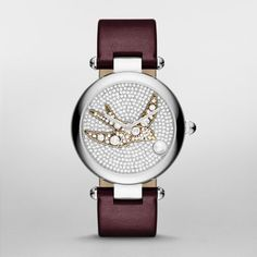 Dotty Oxblood Leather and Stainless-Steel Three-Hand Watch A vintage jewelry-inspired crystal-studded sparrow flies across the pavé crystal-studded dial of the Marc Jacobs Dotty watch, accented by a cabochon pearl at the four o'clock index. A rounded stainless-steel case and oxblood leather strap complete the look.