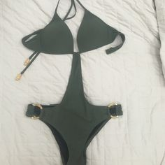 Victoria's Secret Olive green monokini Super sexy olive green monokini by Victoria's Secret.  Picture shown in black is for modeling purpose only.  This suit is green.  Very gently loved.  Size M Victoria's Secret Swim One Pieces
