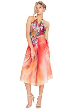 Abstract #printed halter jumpsuit with culotte pants. Features a large keyhole opening on back with a self tie around the neck. Zipper closure on back.