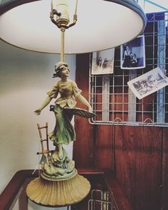 One of the lovely lamps keeping the shop brightly lit (since the sun isn\'t doing its job this week ) . . #vintagelamp #vintagephotos #mrspinkadot #downtownnorfolkva #ghent #shopgranby #757localbiz #ghentnorfolk #norfolkva #lamplove #theladyandthelamp #antiques #treasurehunt #consignmentshop #hamptonroads #homedecor #vintagedecor