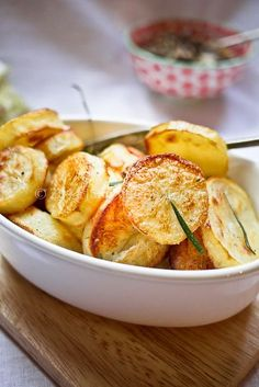 Jamie Oliver's Perfect Roasted Potatoes ~ Perfectly crispy on the outside while maintaining a soft and tender center....