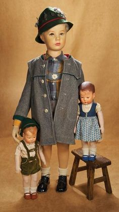"""A German """"Käthe Kruse store mannequin doll"""" for children's clothing . posed with two of the Käthe Kruse Dolls. Made in Germany, by Käthe Kruse. New Dolls, Dolls Dolls, Dollhouse Dolls, Boy Doll, Antique Toys, Doll Face, Mannequins, Vintage Dolls, Beautiful Dolls"""