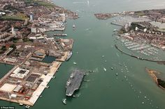 This aerial shot shows the sheer size of HMS Queen Elizabeth, Britain's largest ever warship, as it arrives in Portsmouth