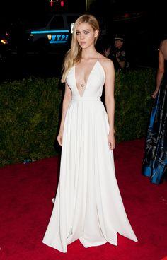 Nicola Peltz cleavage in a white dress.