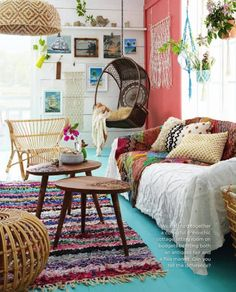 textured pillows, wicker, hanging chair, plants