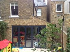 View of the exterior of a sympathetic ground-floor extension at the back of a Victorian house