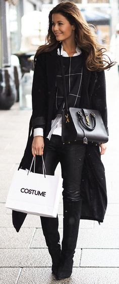 Winter Outfit Ideas: Annette Haga is wearing a black long coat and trousers from Nelly, grid print top from Weekday, boots from Gestuz and the bag is from Yves Saint Laurent