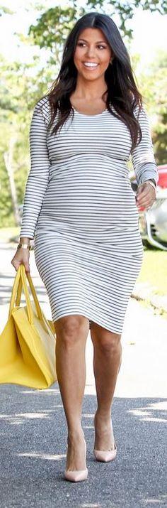 Kourtney Kardashian: Shirt and skirt – Lovers + Friends Purse – Celine Shoes – Manolo Bracelet – Cartier
