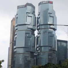 The Lippo Center twin towers look like koalas climbing trees, Queensway - Hong Kong. #travel #throwback - @Melissa Squires Z.- #webstagram
