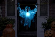 Set up some haunting, mid-air digital decorations that are totally worth the extra effort. | 32 Spooky Ways To Turn Your Home Into A Haunted House