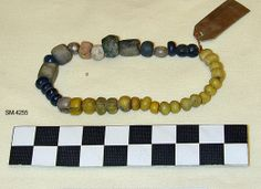 Glass beads from Larvik, Vestfold, Norway.  No discovery information available.  Dated to about the mid-10th century C.E.  In the Telemark Museum.