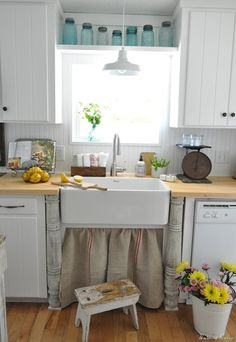 Tiny kitchen inspiration. Love the sink & wooden posts, love the burlap skirt, love the shelf with the mason jars, love the white cupboards & wood countertops... LOVE this design!