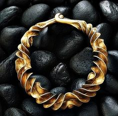 Gold Necklace — Circa 600 BCE — Discovered in a Danish bog — No further reference provided.