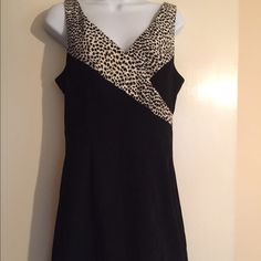 Xoxo body on dress- v neck and back- zips in back Xoxo body on dress- v neck and back- zips in back- sz 9- little black dress with animal print accent❤️ XOXO Dresses Mini