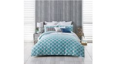 Featuring an original design by Florence Broadhurst, the Kabuki Teal Quilt Cover Set is printed with a series of Japanese fans boldly arranged across a white background. The quilt cover features a self-flange and printed reverse.